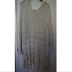 Crocheted dress with hood. Versatile piece